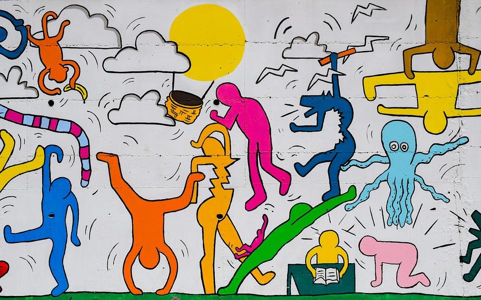 Grafitti med en masse figurer, der bevæger sig