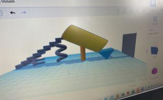 Skærmdump af en digital 3D tegning af en rutchebane inde i et rør. Der er konstrueret en blå trappe og et gult rør. Rutchebanen og trappen står på fjedre, så de kan hoppe/bevæge sig.