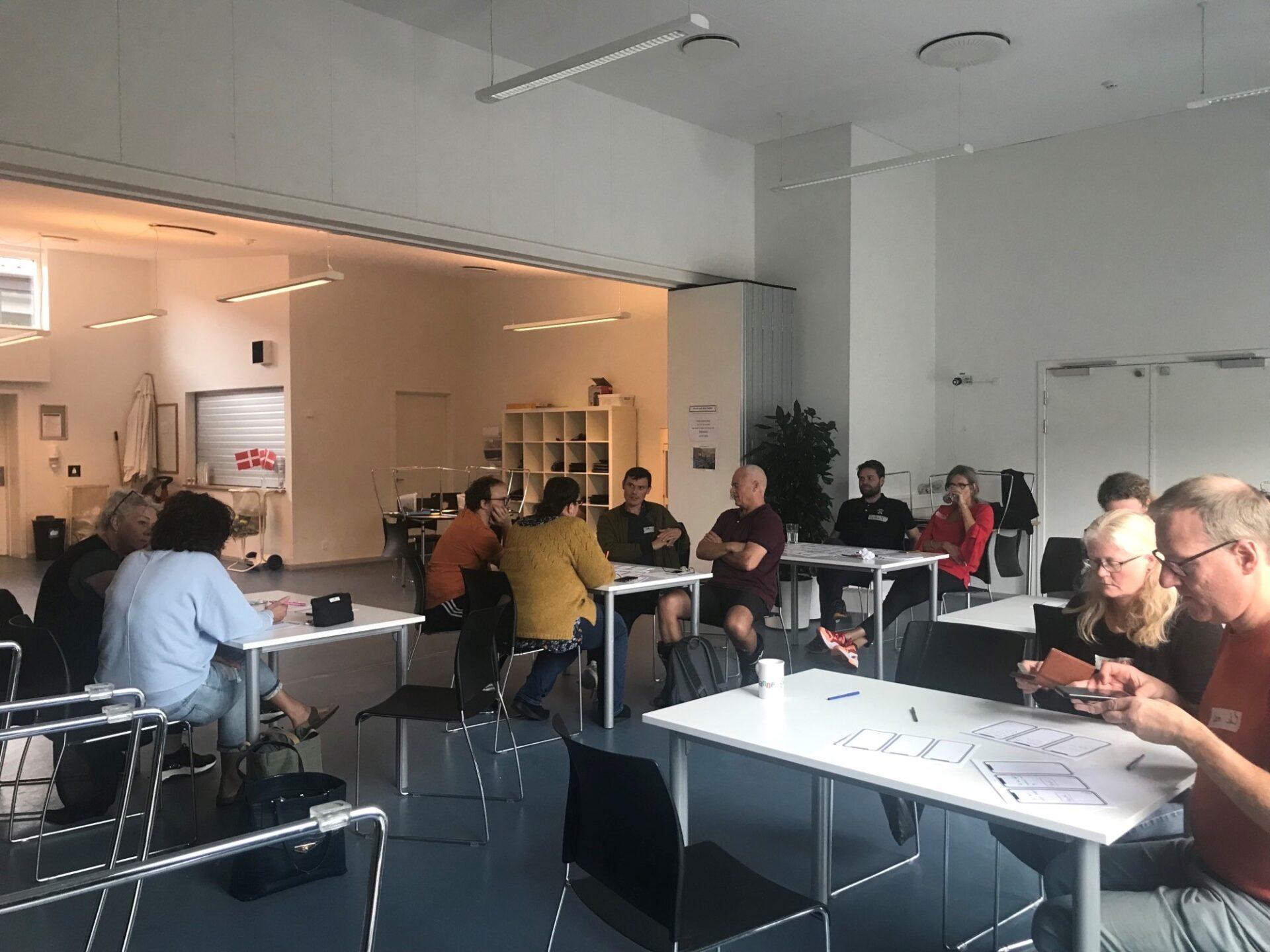 Workshop hvor deltagere arbejder gruppevis